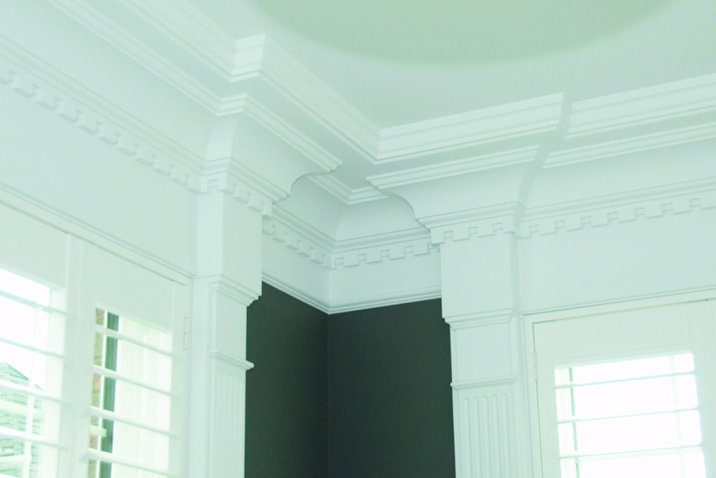 Millwork columns and crown with dentil moulding and large crown
